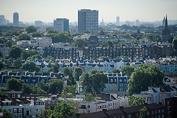 © Licensed to London News Pictures. 14/06/2017. London, UK. A view over the rooftops of Notting Hill in west London showing the contrasting styles of building. Photo credit: Ben Cawthra/LNP