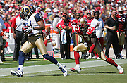 SAN FRANCISCO - SEPTEMBER 17:  Wide receiver Torry Holt #81 of the St. Louis Rams catches a pass while defended by cornerback Walt Harris #27 of the San Francisco 49ers at Monster Park on September 17, 2006 in San Francisco, California. The Niners defeated the Rams 20-13. ©Paul Anthony Spinelli *** Local Caption *** Torry Holt;Walt Harris