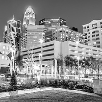 Charlotte North Carolina at night black and white panorama image with Romare Bearden Park and downtown Charlotte buildings. Charlotte is a major city in North Carolina in the Eastern United States of America. Panorama image ratio is 1:3.