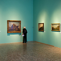 A journalist stands in front of a painting during the Press Preview at Museo Correr of the Guardi Exhibition From September 29th 2012 to January 6th 2013.In the third centenary of the birth of Francesco Guardi, the last great landscape artist of the 18th century, the monographic exhibition promoted by the Fondazione dei Musei Civici di Venezia aims to highlight his complex artistic production, from the lesser-known figure paintings of his youth to the 'interior scenes', concluding with the splendid views of Venice and his fabulous capriccios, painted in his maturity and old age.