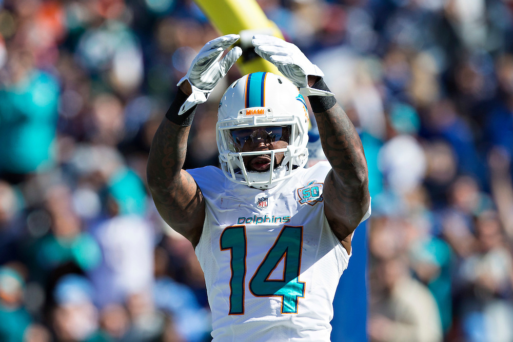 NASHVILLE, TN - OCTOBER 18:  Jarvis Landry #14 of the Miami Dolphins signals after scoring a touchdown against the Tennessee Titans at LP Field on October 18, 2015 in Nashville, Tennessee.  The Dolphins defeated the Titans 38-10.  (Photo by Wesley Hitt/Getty Images) *** Local Caption *** Jarvis Landry