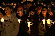 Mourners grieve at a candlelight vigil for the victims in the Virginia Tech shootings in Blacksburg, Virginia April 17, 2007.  REUTERS/Rick Wilking (UNITED STATES)