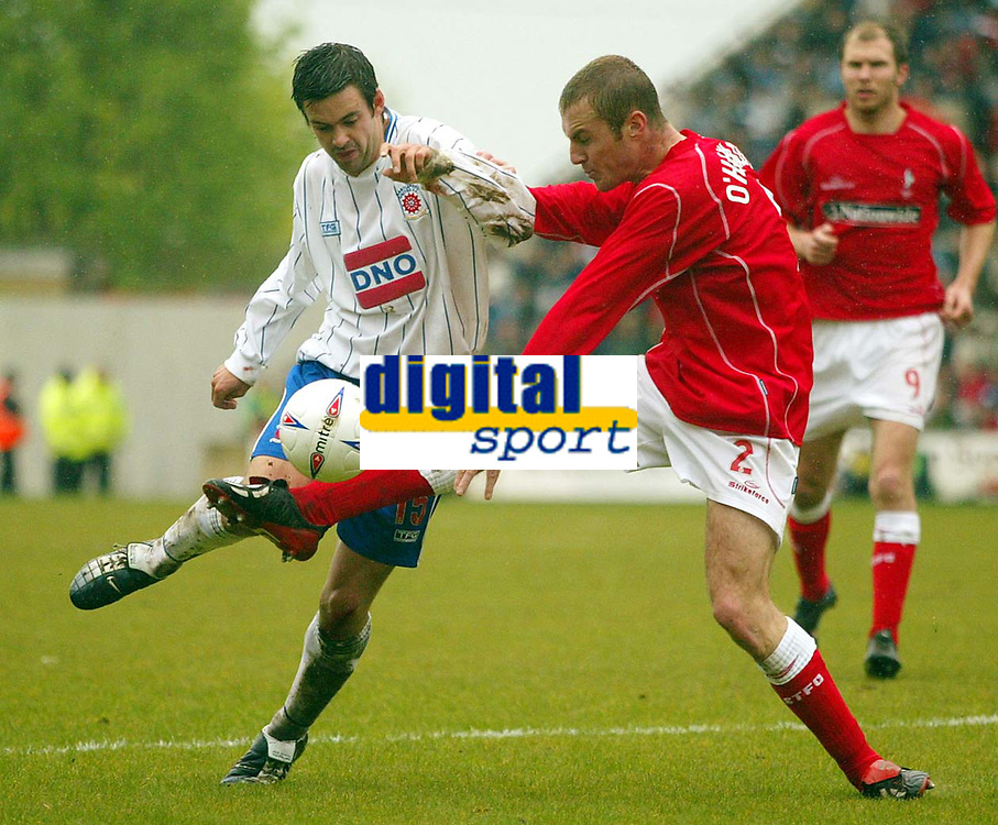 Photo: Scott Heavey.<br /> Digitalsport<br /> NORWAY ONLY<br /> Swindon Town v Hartlepool United. Nationwide Division Two. 08/05/2004.<br /> Andy Boyd (L) is tackled by Swindon's Sean O'Hanlon