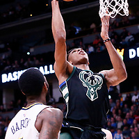 01 April 2018: Milwaukee Bucks forward Giannis Antetokounmpo (34) goes for the layup during the Denver Nuggets 128-125 victory over the Milwaukee Bucks, at the Pepsi Center, Denver, Colorado, USA.