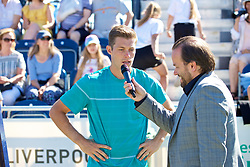 LIVERPOOL, ENGLAND - Sunday, June 24, 2018: Neal Skupski, (GBR) talks with Radio City DJ Simon Greening during day four of the Williams BMW Liverpool International Tennis Tournament 2018 at Aigburth Cricket Club. (Pic by Paul Greenwood/Propaganda)
