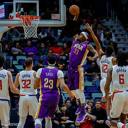 Jan 28, 2018; New Orleans, LA, USA; New Orleans Pelicans forward Dante Cunningham (33) dunks over LA Clippers guard Tyrone Wallace (12) during the first quarter at the Smoothie King Center. Mandatory Credit: Derick E. Hingle-USA TODAY Sports