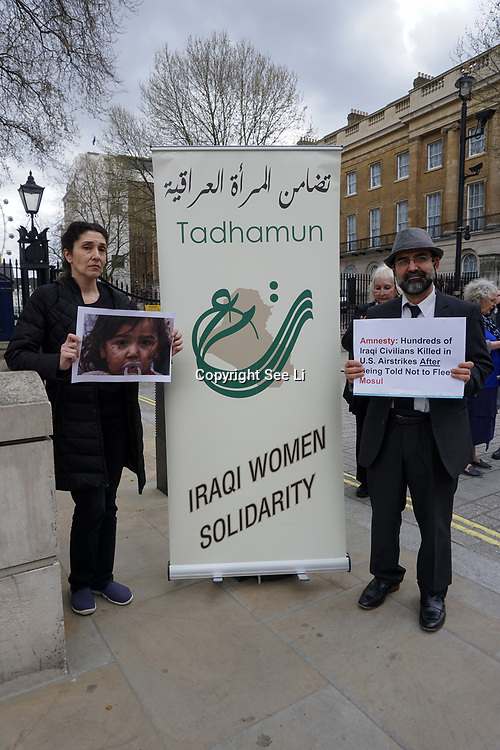 "London, UK. 1st April, 2017. TADHAMUN ""Iraq Women Solidarity"" protest against US bombing of Mosul killed over 200 civilians on 17th Marck 2017 at West Mosul. Protests demand the bombing to Stop, In fact US is not bombing ISIS but civilians. Why you killing us? outside Downing street,London,UK. by See Li"