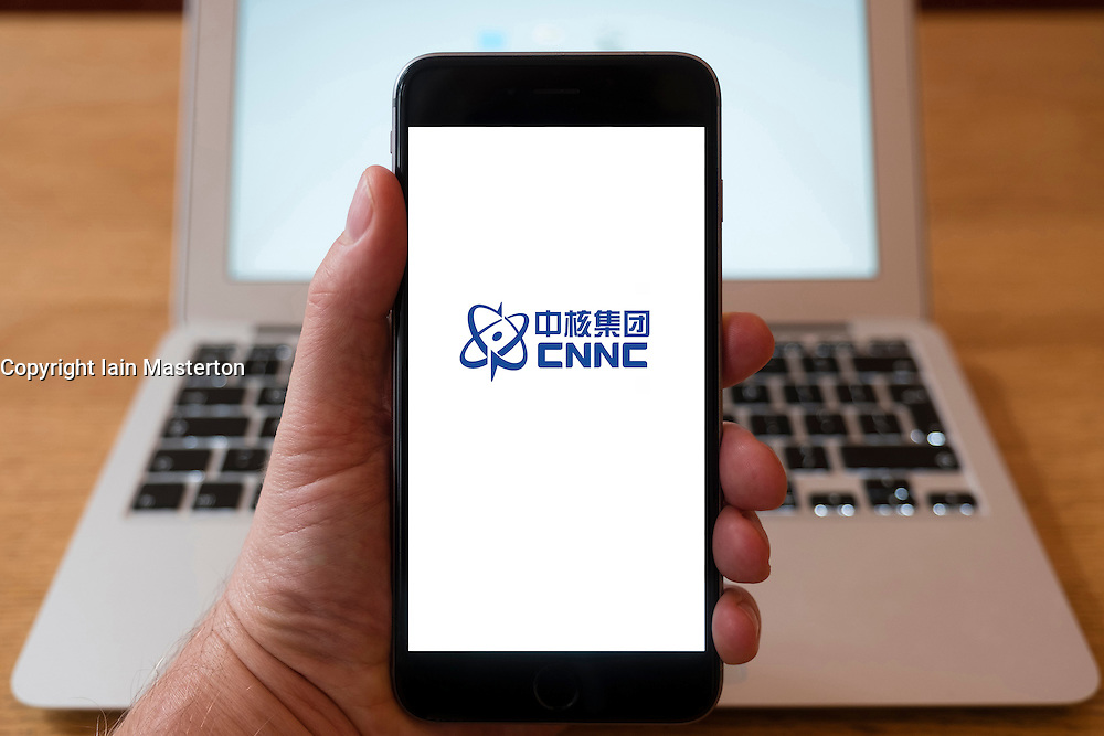 Using iPhone smartphone to display logo of CNNC, China National Nuclear Corporation