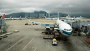 A Cathay Pacific Airbus A340 at a boarding gate at Hong Kong Airport.