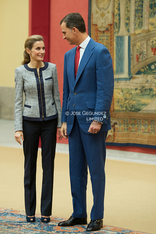 King Felipe VI of Spain and Queen Letizia of Spain attends a meeting with representatives of institutions of social solidarity at Palacio de El Pardo on June 24, 2014 in Madrid