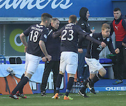 Dundee fitness and conditioning coach Tom Ritchie puts the players through their half time warm up - Queen of South v Dundee, SPFL Championship at Palmerston Park <br />