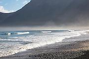 Atlantic Ocean coast beach and waves with morning sea mist, Caleta de Famara, Lanzarote, Canary islands, Spain