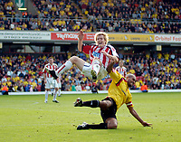 Photo: Leigh Quinnell.<br /> Watford v Sheffield United. Coca Cola Championship.<br /> 17/09/2005. Watfords Clarke Carlise sends Sheffield Uniteds Rob Kozluk up in the air after an off the ball challenge.