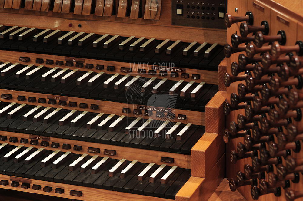 pipe organ keyboard with stops