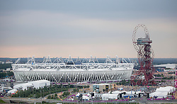© Licensed to London News Pictures. 27/07/2012. LONDON, UK. The Olympic Stadium and the ArcelorMittal Orbit tower are seen in the Olympic Park ahead of the 2012 Summer Olympic opening ceremony in London today (27/07.12). Constituting the third time the Olympic Games have been held in Great Britain, the 2012 Olympic Games, also known as the Games of the XXX Olympiad opened this evening with a show, put together by 'Slum Dog Millionaire' director Danny Boyle, entitled 'The Isles of Wonder. Photo credit: Matt Cetti-Roberts/LNP