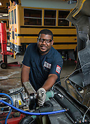 Houston ISD mechanic Derek Thomas poses for a photograph at the Northwest bus barn, July 16, 2014.