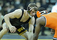 January 07, 2011: Iowa's Mike Kelly and Oklahoma State's Jamal Parks during the 149-pound bout in the NCAA wrestling dual between the Oklahoma State Cowboys and the Iowa Hawkeyes at Carver-Hawkeye Arena in Iowa City, Iowa on Saturday, January 7, 2012. Parks won 8-3.