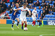 Brian Wilson of Oldham Athletic puts Ryan Colclough of Wigan Athletic under pressure during the EFL Cup match between Oldham Athletic and Wigan Athletic at Boundary Park, Oldham, England on 9 August 2016. Photo by Simon Brady.