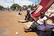 Children sit at the roadside at an unofficial IDP camp at Musina Showground in South Africa. Approximately 2000 displaced persons from Zimbabwe are waiting to be processed at the camp, they recieve little in the way of support from South African government but reply on one meal a day from NGO's such as Save the Children and IRC...There were 664 confirmed cases of Cholera at the border town of Musina in South Africa. Officially the outbreak is under control, with the confirmed number of deaths from Cholera at 8 people. 51 of those admitted to the hospital have been under the age of 5 years old...Limpopo Health department has been working closely with IRC, Save the Children (UK), WHO and MSF to bring the outbreak under control through treatment and education programs in bordering villages and at the main IDP camp at Musina Showground..