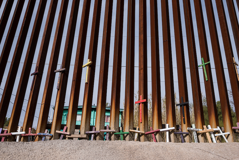 Crosses are gathered along the U.S.-Mexico border wall in Nogales, Sonora.