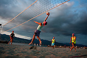 Summer 2012:<br /> <br /> Dan Malinsky jumps up for a spike during a Wednesday evening game of beach volleyball in August at the east end of Locarno Beach in Vancouver.  Malinsky's teammates are, from left, Kristen Suess, Jesse Atkinson and Tamiko Young.   <br /> <br /> (Kathleen Hinkel/photographer)