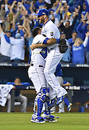 Oct 23, 2015; Kansas City, MO, USA; Kansas City Royals relief pitcher Wade Davis (17) and catcher Salvador Perez (left) celebrate after defeating the Toronto Blue Jays in game six of the ALCS at Kauffman Stadium. Mandatory Credit: Peter G. Aiken-USA TODAY Sports