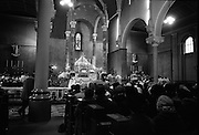 St Valentine Commemorated..1968..14.02.1968..02.14.1968..14th February 1968..On St Valentine's Day, the remains of the saint, which are kept in the Carmelite Church in Whitefriar Street, Dublin, are taken from the shrine to the high altar where a special Mass is celebrated.  ..A view of the altar and some of the congregation taken during the ceremony to commemorate St Valentine.