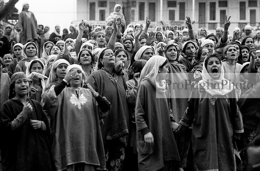 Jammu & Kashmir, Srinagar April 1994.<br /> Women are protesting against the atrocities committed by Indian soldiers.In this occasion they were standing at the entrance of a park to protest the murder of a greengrocer and to block the path of soldiers who were trying to stop the ceremony. Torture is widely practised in Kashmir as a means of extracting information from detainees, coercing confessions, punishing persons believed sympathetic to the militants and creating a climate of political repression.Torture include severe methods, which include the psico-torture: soldiers rape the detainee's wife in front of his eyes.