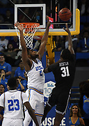 Nov 6, 2019; Los Angeles, CA, USA; Long Beach State 49ers guard Chance Hunter (31) is defended by UCLA Bruins forward Cody Riley (2)at Pauley Pavilion. UCLA defeated Long Beach State 69-65.