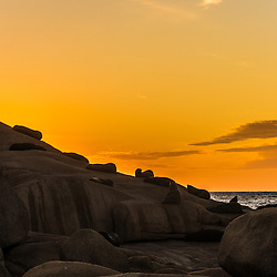 Silhoutte of sea lions on a rock at sunset, Cabo Polonio, Uruguay.
