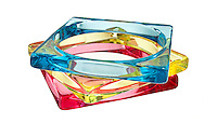 Blue, red, and yellow resin bangles on white background