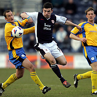 Raith Rovers v St Johnstone...12.03.05<br />John Martin skips a tackle by Paul Sheerin<br /><br />Picture by Graeme Hart.<br />Copyright Perthshire Picture Agency<br />Tel: 01738 623350  Mobile: 07990 594431