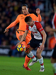SOUTHAMPTON, ENGLAND - Sunday, February 11, 2018: Liverpool's Virgil van Dijk and Southampton's Guido Carrillo during the FA Premier League match between Southampton FC and Liverpool FC at St. Mary's Stadium. (Pic by David Rawcliffe/Propaganda)