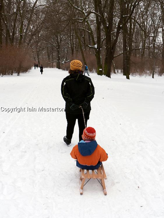 Families enjoying winter snow in Treptower Park in Berlin germany