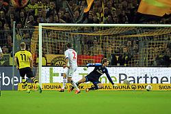 14.09.2013, Signal Iduna Park, Dortmund, GER, 1. FBL, Borussia Dortmund vs Hamburger SV, 5. Runde, im Bild Marco Reus #11 (Borussia Dortmund) mit dem Tor zum 5:2 gegen Torwart Rene Adler #15 (Hamburger SV), // during the German Bundesliga 5th round match between Borussia Dortmund and Hamburger SV at the Signal Iduna Park, Dortmund, Germany on 2013/09/14. EXPA Pictures © 2013, PhotoCredit: EXPA/ Eibner/ Joerg Schueler<br /> <br /> ***** ATTENTION - OUT OF GER *****