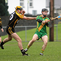 10/11/13 O'Callaghan's Mills Sean O Gorman makes no mistake clearing the ball while under pressure from Ballyea's Niall Deasey during the Senior B Hurling Championship Final in Sixmilebridge. Pic Tony Grehan / Press 22