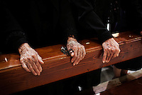 "PERDASDEFOGU, SARDINIA, ITALY - 30 JUNE 2013: A detail of Claudina Melis'  hands (left) during the mass celebrating her 100th birthday in St- Peter's church in Perdasdefogu, Italy, on June 30th 2013.<br /> <br /> Last year, the Melis family entered the Guinness Book of World Records for having the highest combined age of any nine living siblings on earth — today more than 825 years. The youngest sibling, Mafalda – the ""little one"" – is 79 years old.<br /> <br /> The Melis siblings were all born in Perdasdefogu to Francesco Melis and Eleonora Mameli, who had a general store. Consolata, 106, is the oldest, then Claudia, 100; Maria, 98; Antonino, 94; Concetta, 92; Adolfo, 90; Vitalio, 87; Fida Vitalia, 81; and Mafalda, the baby at 79. Their descendants now account for about a third of the village."