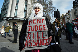 © Licensed to London News Pictures. 22/02/2020. LONDON, UK.  A woman dressed as a judge takes part in a march from Australia House in Aldwych to Parliament Square in support of Wikileaks founder Julian Assange.  The full extradition trial of Mr Assange begins in London on 24 February.  Photo credit: Stephen Chung/LNP