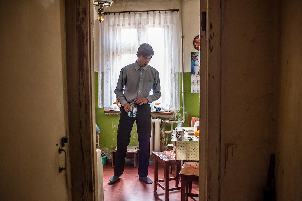 LUHANSK, UKRAINE - MARCH 15, 2015: Pavel Pavlov prepares tea in his mother's apartment in Luhansk, Ukraine. CREDIT: Brendan Hoffman for The New York Times