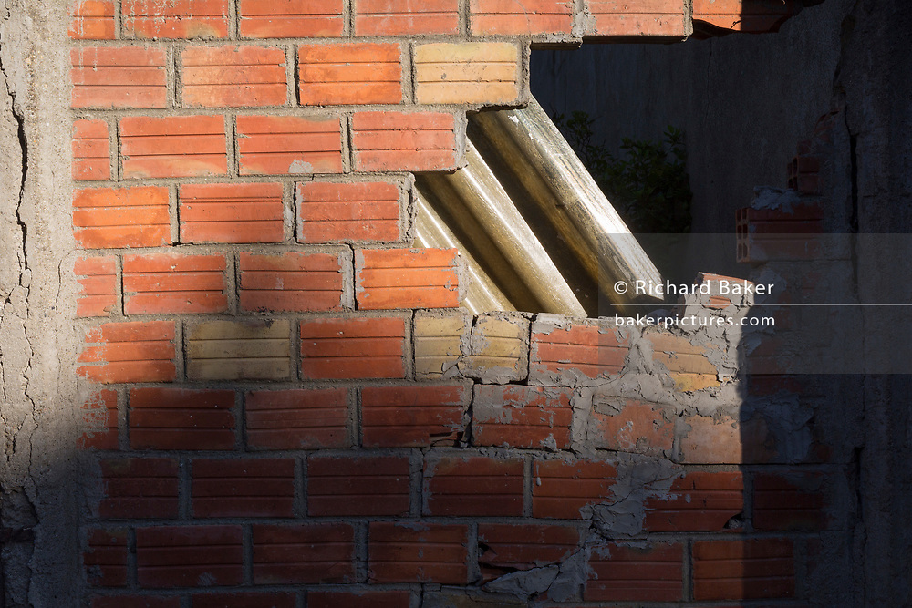 Collapsing workmanship in progress of a new brick wall on 25th May, 2017, in Lagrasse, Languedoc-Rousillon, south of France.