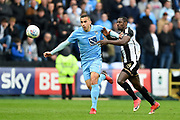 Coventry City's Rod McDonald (5) holds off Notts County forward Jonathan Forte (14) during the EFL Sky Bet League 2 match between Notts County and Coventry City at Meadow Lane, Nottingham, England on 7 April 2018. Picture by Jon Hobley.