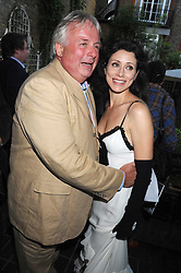 CHRISTOPHER BIGGINS and ANGELA NEWLEY at a private view of work by Sacha Newley entitled 'Blessed Curse' in association with the Catto Gallery held at the Arts Club, Dover Street, London W1 on 2nd July 2008.<br />