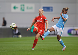 MANCHESTER, ENGLAND - Sunday, August 30, 2015: Liverpool's captain Gemma Bonner and and Manchester City's Nikita Parris during the League Cup Group 2 match at the Academy Stadium. (Pic by Paul Currie/Propaganda)