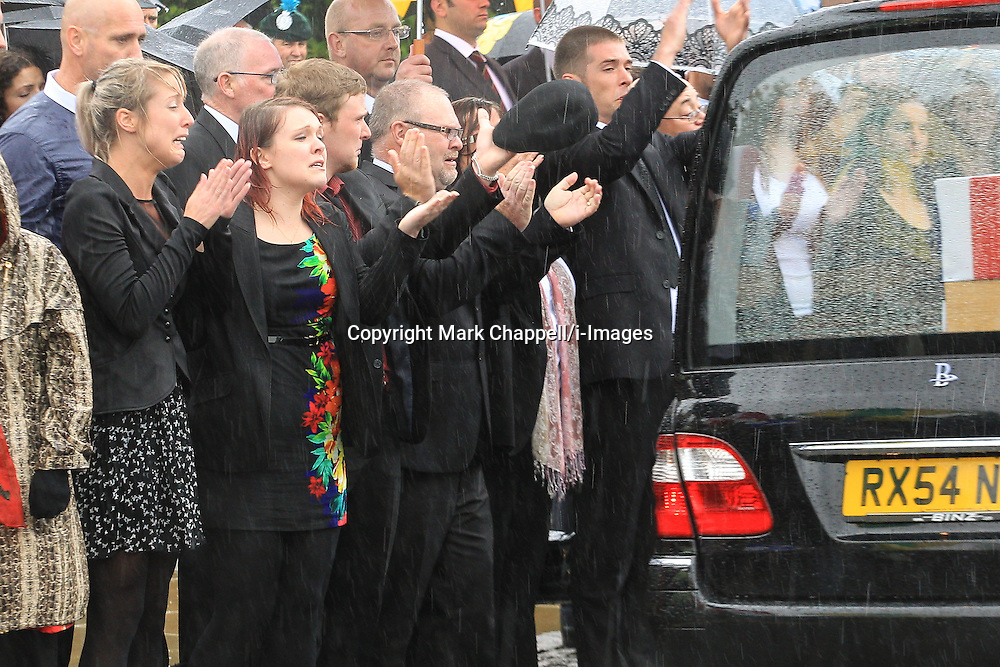 Sisters Rosie-Ann Stone (black dress, brunette) and Jennie Stone (Polkadot dress, blonde) pictured at the repatriation of their brother Gregg's body from Afghanistan in June 2012.<br /> Rosie-Ann has pleaded not guilty to a charge of causing death by careless driving at Bridlington Magistrates&rsquo; Court. In tragic circumstances, the car crash in February resulted in the death of her sister, Jennie, who was driving another car along the same stretch of road and collided with a tree.  Thursday 07  June  2012.  Carterton, UK.<br /> Photo by: Mark Chappell/i-Images