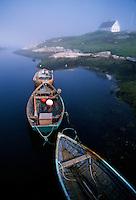 Three fishing boats moored together in Peggy's Cove, near Halifax, Nova Scotia, Canada