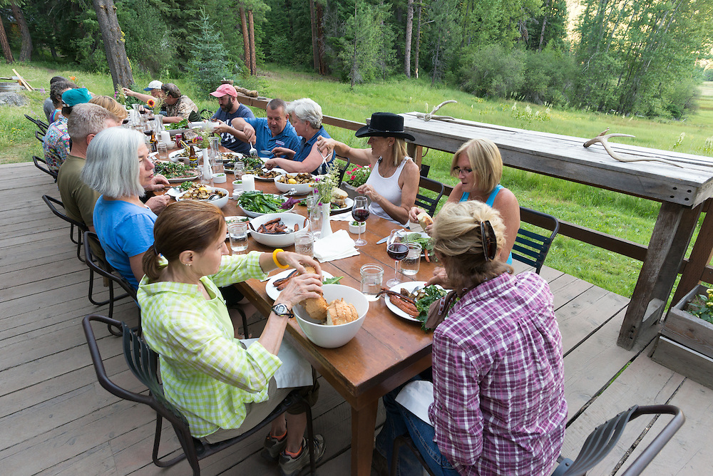 Eating dinner on the Minam River Lodge in Oregon's Wallowa Mountains.
