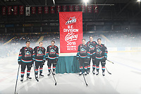KELOWNA, CANADA - SEPTEMBER 22:  Leif Mattson #28, Kyle Topping #24, Erik Gardiner #11, Jack Cowell #8, Braydyn Chizen #22 and Conner Bruggen-Cate #20 of the Kelowna Rockets stand at centre ice to raise the 2018 BC Division Banner during home opener against the Kamloops Blazers on September 22, 2018 at Prospera Place in Kelowna, British Columbia, Canada.  (Photo by Marissa Baecker/Shoot the Breeze)  *** Local Caption ***