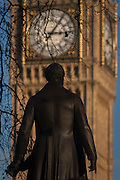 "The statue of Sir Robert Peel and the Elizabeth Tower of the British Houses of Parliament, on 17th January 2017, in Parliament Square, London England. The Elizabeth Tower (previously called the Clock Tower) named in tribute to Queen Elizabeth II in her Diamond Jubilee year – was raised as a part of Charles Barry's design for a new palace, after the old Palace of Westminster was largely destroyed by fire on the night of 16 October 1834. The new Parliament was built in a Neo-gothic style, completed in 1858 and is one of the most prominent symbols of both London and England. Sir Robert Peel, was a British statesman and member of the Conservative Party, served twice as Prime Minister of the United Kingdom and twice as Home Secretary. He created the modern police force and officers known as ""bobbies"" and ""peelers"""