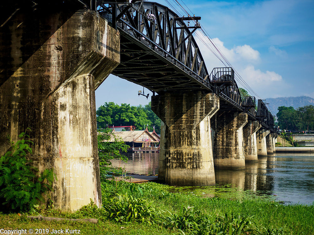 """09 JANUARY 2019 - KANCHANABURI, THAILAND: The """"Bridge On the River Kwai"""" in Kanchanaburi. Hundreds of thousands of Asian slave laborers and Allied prisoners of war died in World War II constructing the """"Death Railway"""" between Bangkok and Rangoon (now Yangon), Burma (now Myanmar) for the Japanese during World War II.  The bridge is now one of the most famous tourist attractions in Thailand.      PHOTO BY JACK KURTZ"""