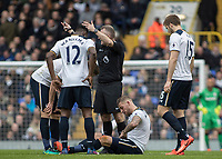 Football - 2016 / 2017 Premier League - Tottenham Hotspur vs. Stoke City<br /> <br /> Referee John Moss calls for a stretcher after Toby Alderweireld of Tottenham sits injured at White Hart Lane.<br /> <br /> COLORSPORT/DANIEL BEARHAM